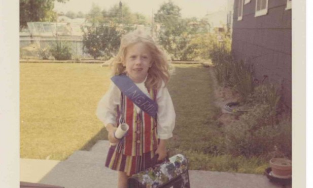 Ingrid Tischer on the day of her kindergarten graduation in Greece, New York, circa 1969. She is wearing a rainbow vest and skirt sown by her mom. Note the clutching of the diploma and school-bestowed book-bag, and anxious expression -- all indicate a future in literary fiction writing and nonprofit fundraising.