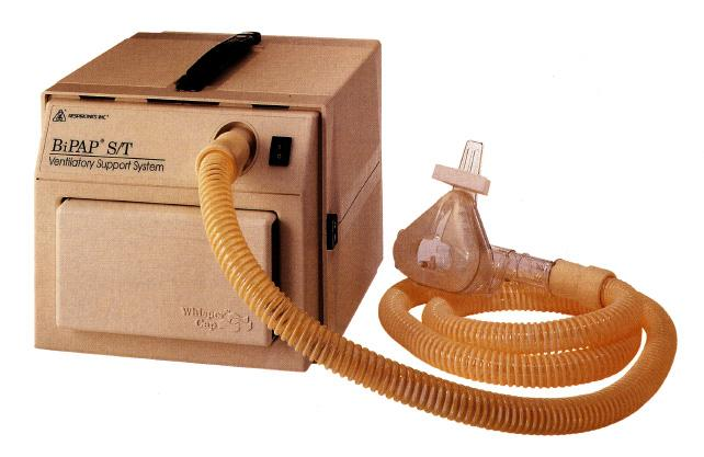 Photo of a Respironics BiPap S/T with hose and mask