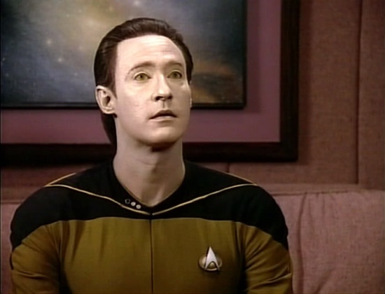 Lt. Data poised to make a report.
