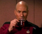 Captain Picard thoughtful and sipping what we can only assume to be tea, Earl Grey, hot.