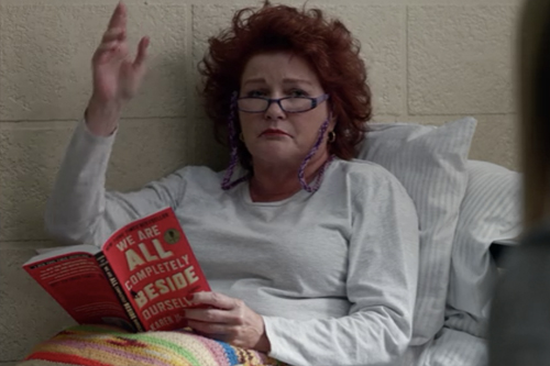 The former and fallen Commander Janeway aka Red waving tiredly from her bunk in Litchfield Federal Penitentiary