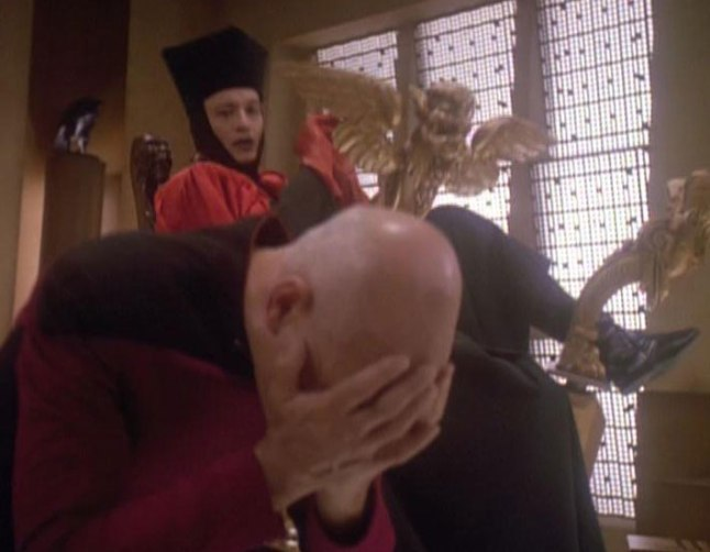 Q and Picard, face in his hands