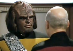 Worf talking with Picard