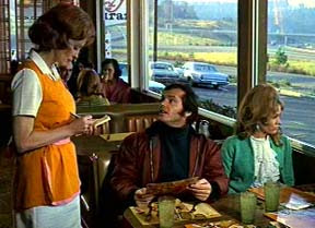 "Screen shot from the film ""Five Easy Pieces"" in which Jack Nicholson's character tries in vain to order a breakfast combo but with wheat toast in place of the potatoes. The middle-aged waitress is pursing her lips as she is writing on her order pad. Jack is sitting in a booth next to Karen Black, who plays his girlfriend."