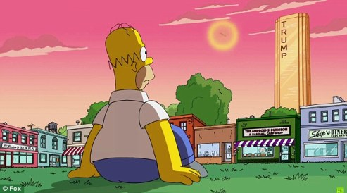 Homer sitting on the grass in downtown Springfield, gazing at a towering golden Trump building