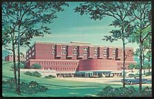 A color rendering of a large mid-century red brick building with a large rounded marquee over the entrance. It's placed on parkland.